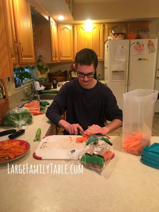 Chopping Carrots for Large Family Snacks